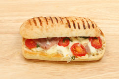 Pannini on a wooden board Stock Photography