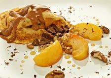 Pannkaka och äpplen Arkivfoto