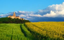 Pannonhalma Abbey with wheat and rapeseed field, Hungary. The Benedictine Pannonhalma Archabbey or Territorial Abbey of Pannonhalma is the most notable landmark Stock Photography