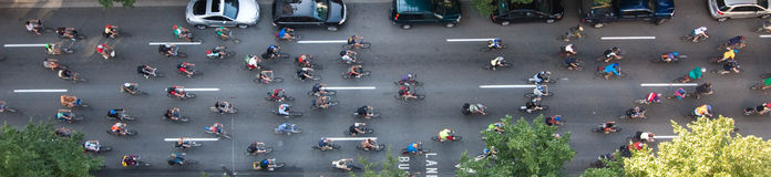 Pano bikers. Bikers travelling through the city to make an environmental friendly statement, shot from above Royalty Free Stock Image