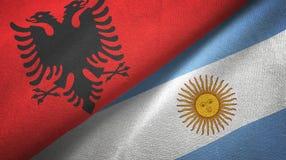 Pano de matéria têxtil das bandeiras de Albânia e de Argentina dois, textura da tela ilustração royalty free