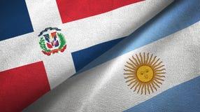 Pano de matéria têxtil das bandeiras da República Dominicana e da Argentina dois, textura da tela ilustração stock