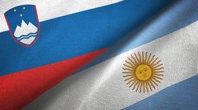 Pano de matéria têxtil das bandeiras do Eslovênia e da Argentina dois, textura da tela ilustração royalty free