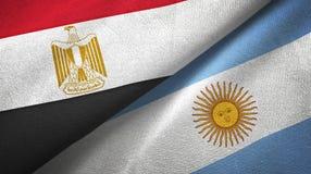 Pano de matéria têxtil das bandeiras de Egito e de Argentina dois, textura da tela ilustração stock