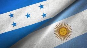 Pano de mat?ria t?xtil das bandeiras das Honduras e da Argentina dois, textura da tela ilustração royalty free