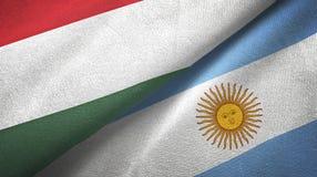 Pano de matéria têxtil das bandeiras de Hungria e de Argentina dois, textura da tela ilustração royalty free