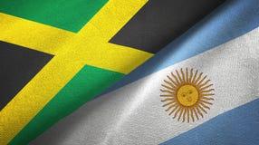 Pano de matéria têxtil das bandeiras de Jamaica e de Argentina dois, textura da tela ilustração royalty free