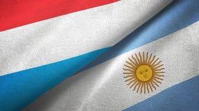 Pano de matéria têxtil das bandeiras de Luxemburgo e de Argentina dois, textura da tela ilustração royalty free