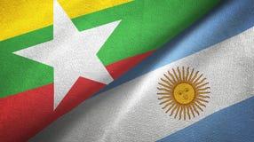 Pano de matéria têxtil das bandeiras de Myanmar e de Argentina dois, textura da tela ilustração royalty free