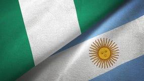 Pano de matéria têxtil das bandeiras de Nigéria e de Argentina dois, textura da tela ilustração royalty free