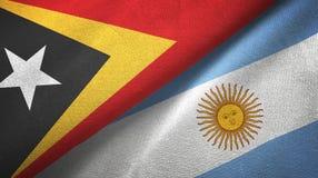 Pano de matéria têxtil das bandeiras de Timor-Leste e de Argentina dois, textura da tela ilustração stock
