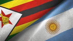 Pano de mat?ria t?xtil das bandeiras de Zimbabwe e de Argentina dois, textura da tela ilustração royalty free