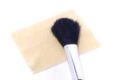 Pano e escova Imagens de Stock
