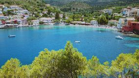 Pano footage of beautiful cute greece Assos village location on summer time on Kefalonia island. Travel, lifestyle