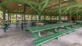 Free Pano Interior Of Pavilion With Green Picnic Tables And Seats At A Park On A Sunny Day Royalty Free Stock Photo - 168709915