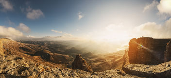 Pano majestic cliffs painted by the setting sun in the golden color against royalty free stock image