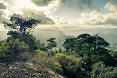 Pano Platres in Troodos mountains, Cyprus. Beautiful landscape with the sun coming through the sky Royalty Free Stock Images