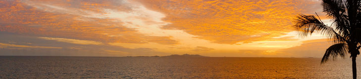 Pano: Sunset in tropical Fiji. Looking out towards the sun setting over the Mamanuca Islands, in tropical Fiji royalty free stock images