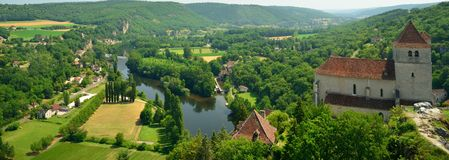 Panomaric view of the Lot river and old church in France Royalty Free Stock Photos