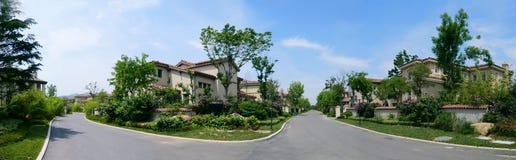 Panorámico de casas de la vecindad Imagen de archivo libre de regalías