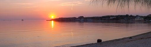 Panoram de coucher du soleil de mer Photos stock