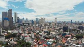 Panorama aéreo del centro de ciudad con los rascacielos Jakarta indonesia almacen de metraje de vídeo