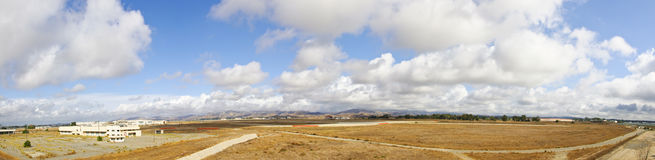 Panorama Abandoned Air Field. Panorama of an Abandoned Air Field in Irvine California with beautiful clouds Stock Photography