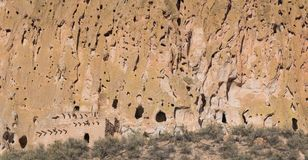 Panorama of abandoned ancient cliff dwellings and caves in a colorful cliff face royalty free stock photos