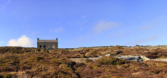 Panorama of Abandoned House in the Heather Field Stock Photo