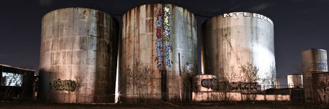 Panorama of abandoned silos at night stock photography
