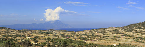 Panorama of Aegean coast. View of Mount Athos. Royalty Free Stock Image