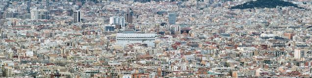 Panorama aerial cityscape view of barcelona showing the dense crowded modern urban environment with housing and modern business de royalty free stock image