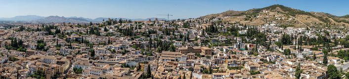Panorama Aerial view of the city of Granada, Albaycin , viewed f. Rom the Alhambra palace in Granada, Spain, Europe on a bright summer day with blue sky Royalty Free Stock Image