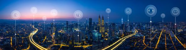City scape and network connection concept. Panorama aerial view in the  cityscape skyline  with smart services and icons, internet of things, networks and Stock Photography