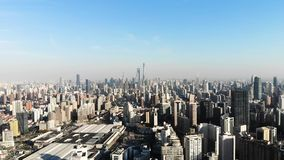 Panorama Aerial View of Shanghai skyline on a sunny day. Flying above Puxi, Pudong and Huangpu River stock footage