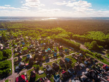 Panorama aerial view shot on cottage village in forest, suburb, village. Stock Photos