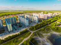 Panorama aerial view shot on cottage village in forest, suburb, village. Royalty Free Stock Photo