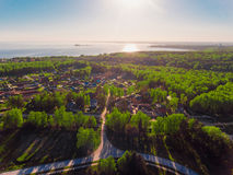 Panorama aerial view shot on cottage village in forest, suburb, village. Royalty Free Stock Photos