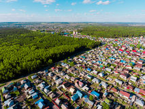 Panorama aerial view shot on cottage village in forest, suburb, village. Stock Images