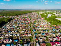Panorama aerial view shot on cottage village in forest, suburb, village. Royalty Free Stock Image