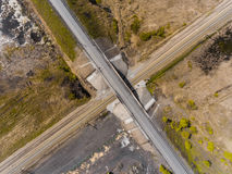 Panorama aerial view shot on the road bridge over railway Royalty Free Stock Images