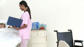Panorama of AfroAmerican nurse talking to a little patient Royalty Free Stock Photo
