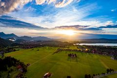 Panorama from the air sunset Forggensee and Schwangau, Germany,. Bavaria Stock Images