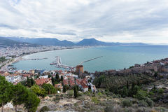 Panorama of Alanya Mediterranean town of Turkey showing sea moun. Tains Red Tower and castle walls shot on gloomy day Royalty Free Stock Image