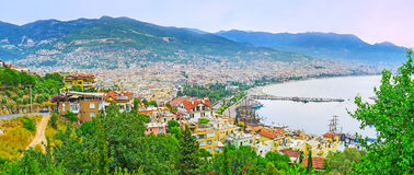 Panorama of Alanya resort from Castle hill. The slopes of the Castle Hill covered with lush gardens, the roofs of old town and modern districts of resort are stock photos