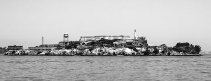 Panorama of Alcatraz Island with famous prison building, San Francisco, USA. Black and white image.  royalty free stock photos