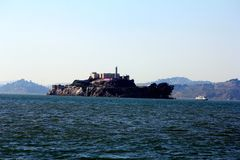 Panorama of Alcatraz Island with famous prison building, San Francisco, USA.  stock photos