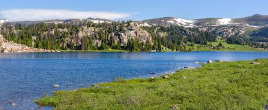 Panorama of an alpine lake along the Beartooth Highway. Yellowstone Park, Wyoming. royalty free stock images