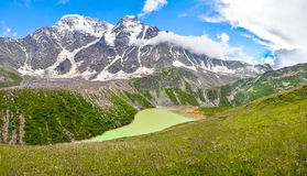 Panorama. Alpine lake in the northern Caucasus Royalty Free Stock Image