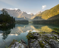 Panorama of Alpine lake,Sunrise over the alpine lake Laghi di Fusine Stock Image